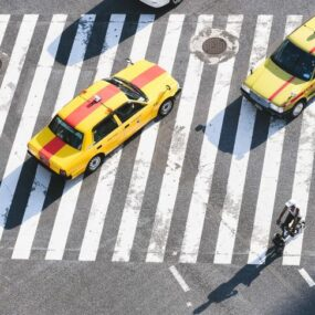 cars taxis on zebra crossing